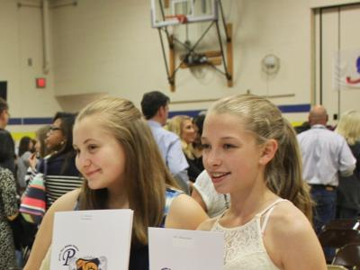 Rocky Run NJHS students celebrate receiving their pins and certificates