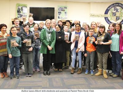 Laura Elliott with students and parents at Parent Teen Book Club