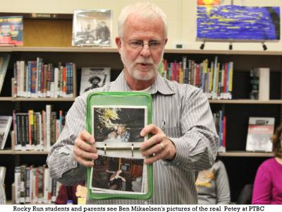 "Author Ben Mikaelsen with a book group at PTBC showing pictures of the ""real Petey"""